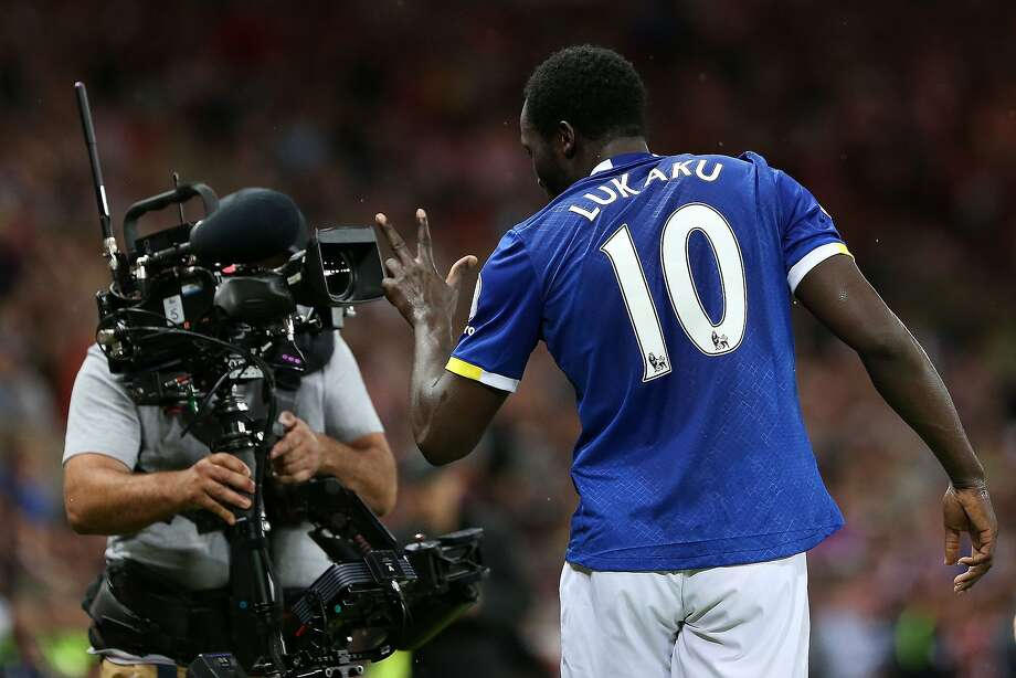 (FILES) In this file photo taken on September 12, 2016 Everton's Belgian striker Romelu Lukaku gestures into the lens of a television (TV) camera as he celebrates scoring his team's third goal during the English Premier League football match between Sunderland and Everton at the Stadium of Light in Sunderland, north-east England. - Piracy poses an existential problem for broadcast rights holders but there are no signs that live sport is losing its glittering allure, according to Eleven Sports chief executive Marc Watson. The company -- a relative upstart in a cut-throat field -- has got its hands on a number of high-profile events this year, adding the UK and Irish rights to the PGA Championship, La Liga and Serie A to a growing portfolio. (Photo by SCOTT HEPPELL / AFP) / RESTRICTED TO EDITORIAL USE. No use with unauthorized audio, video, data, fixture lists, club/league logos or 'live' services. Online in-match use limited to 75 images, no video emulation. No use in betting, games or single club/league/player publications. TO GO WITH AFP STORY BY Pirate Irwin / SCOTT HEPPELL/AFP/Getty Images Photo: SCOTT HEPPELL;Scott Heppell / AFP / Getty Images