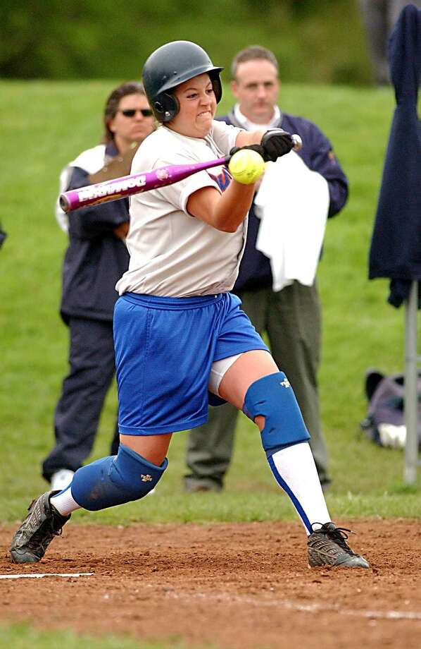 Danbury's Tracy Guerrera gets a hit against Immaculate Photo: File Photo / Timothy Wheeler / File Photo / The News-Times File Photo