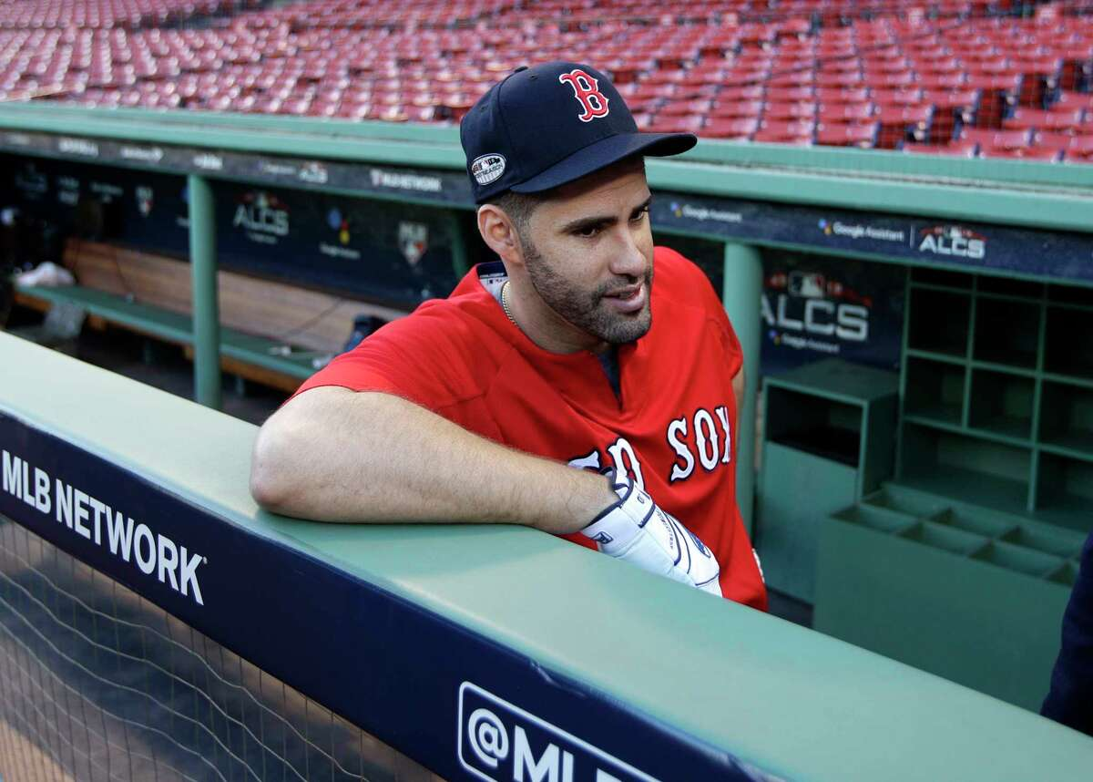 Boston Red Sox's J.D. Martinez speaks to a reporter during a workout at Fenway Park, Friday, Oct. 12, 2018, in Boston. The Red Sox face the Houston Astros in Game 1 of baseball's American League Championship Series on Saturday. AP Photo/Elise Amendola)