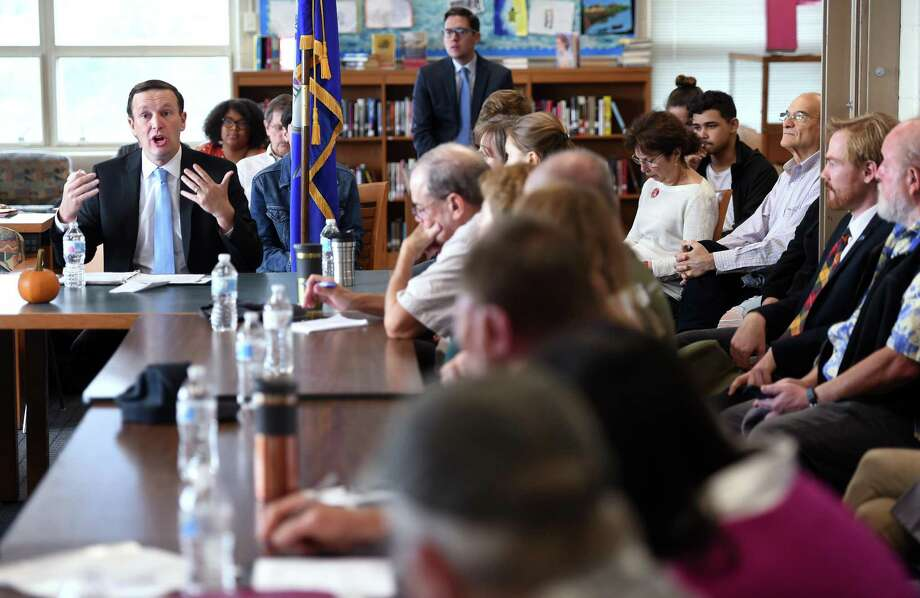 U.S. Sen. Chris Murphy, left, speaks at the Sound School in New Haven Friday about the Long Island Sound Restoration and Stewardship Act that just passed in Congress. Photo: Arnold Gold / Hearst Connecticut Media / New Haven Register