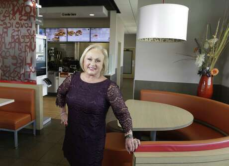 Nelly Quijano poses in one of her McDonald's restaurants Monday, Sept. 24, 2018, in Houston. Two Latino high school graduates from Houston are among five students entering the elite campuses of Brown and Georgetown Universities with scholarships of $100,000 each from the HACER Foundation, a McDonald's organization.