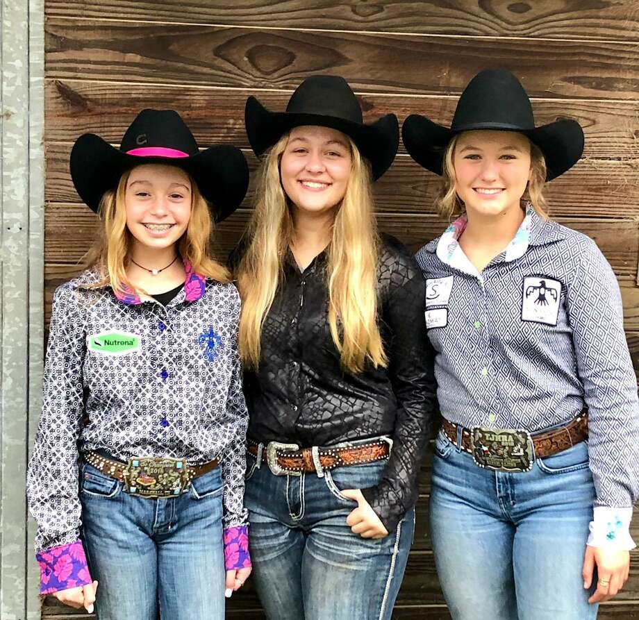 Montgomery County residents Jamie Spikes, 16, Jordan Jackson, 12, and Carson Rutherford, 14, will be traveling to Las Vegas this December to compete in the Junior National Finals Rodeo. Pictured left to right are Jordan Jackson, Jamie Spikes and Carson Rutherford Photo: Courtesy Photo