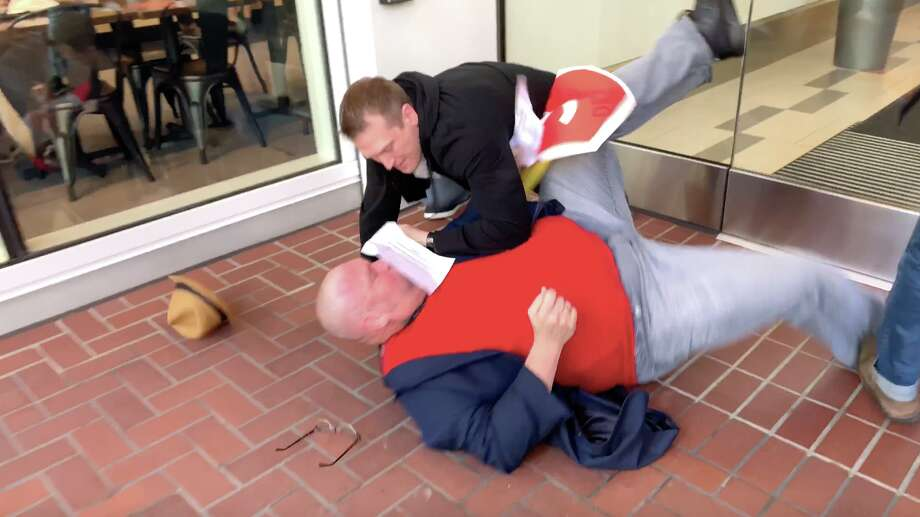 An Uber driver who attempted to deliver a petition to the company's headquarters in San Francisco was tackled to the ground by security. Photo: Gig Workers Rising