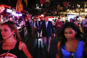 Senator Ted Cruz walks through the Firehouse Saloon before a campaign rally Friday Oct. 12, 2018 in Houston.