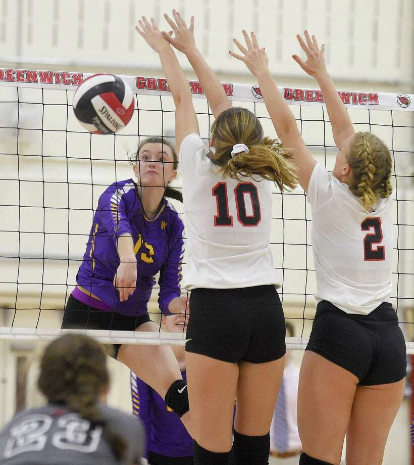 Westhill's Betsy Sachs (13) spikes the ball past Greenwich's Erin O'Keefe (10) and Amelia Bartlett (2) during a FCIAC girls volleyball league match in Greenwich, Conn., Friday, Oct. 12, 2018. Westhill defeated Greenwich, 3-2, to improve to a 14-1 overall record. Photo: Matthew Brown / Hearst Connecticut Media / Stamford Advocate