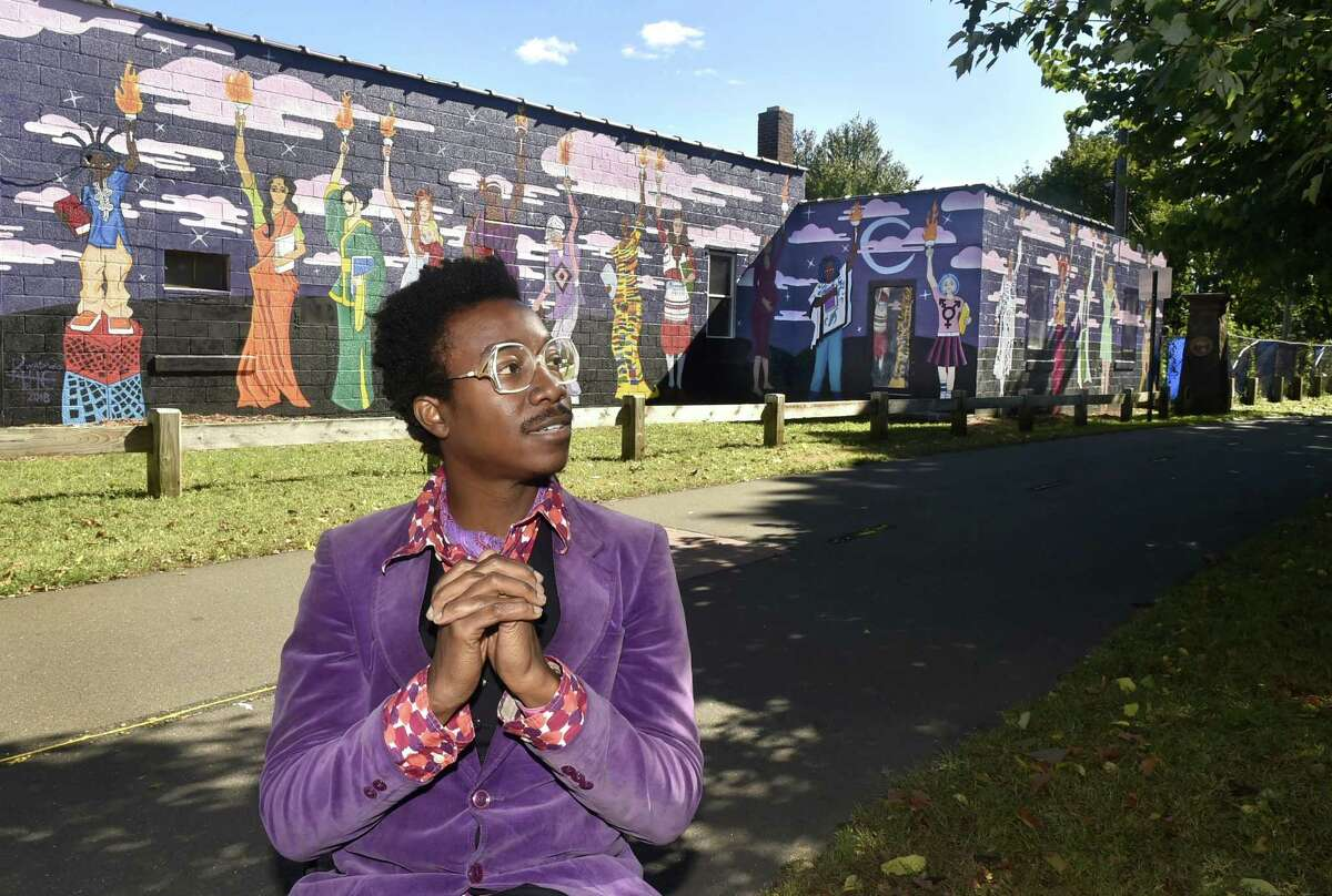 New Haven, Connecticut -Friday, October 12, 2018: Artist / Muralist Kwadwo Adae of Bethany and the Adae Fine Arts Academy in New Haven with his Women's Empowerment Mural on the Farmington Canal Greenway Friday on Goodrich Street near Dixwell Ave. Adae received approximately $26,000 in grants for the project.