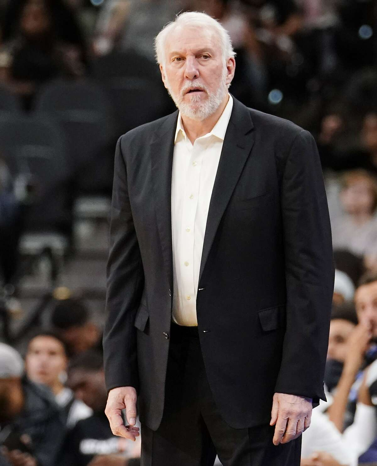 San Antonio Spurs head coach Gregg Popovich watches the second half of an NBA preseason basketball game against the Houston Rockets, Sunday, Oct. 7, 2018, in San Antonio. (AP Photo/Darren Abate)