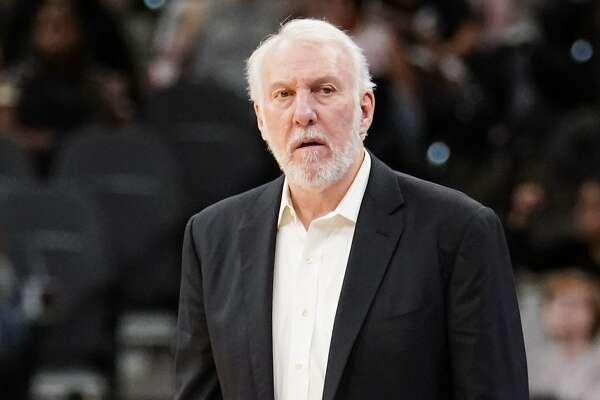 San Antonio Spurs head coach Gregg Popovich watches the second half of an NBA preseason basketball game against the Houston Rockets, Sunday, Oct. 7, 2018, in San Antonio. (AP Photo/Darren Abate)