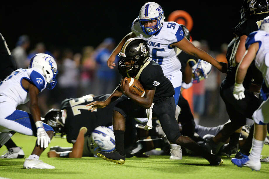 Woodville's Da'Michael Brooks carries against Buna at Woodville's Eagle Stadium on Friday night. 