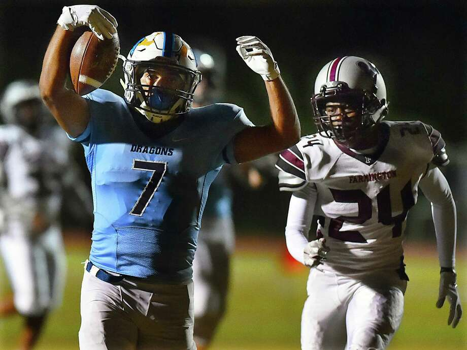 Middletown's Xzavier Reyes celebrates after scoring his second touchdown against Farmington on Friday. Photo: Catherine Avalone / Hearst Connecticut Media / New Haven Register