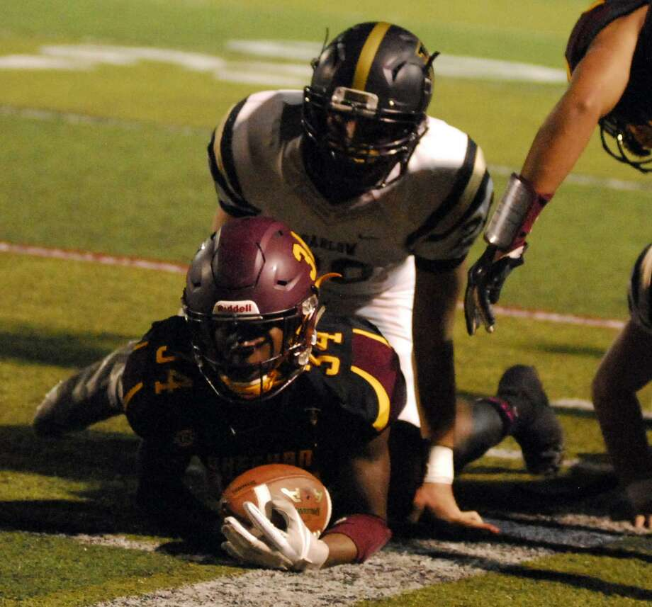 Action from Sheehan's 49-6 win over Barlow on Friday. Photo: Ryan Lacey /Hearst Connecticut Media