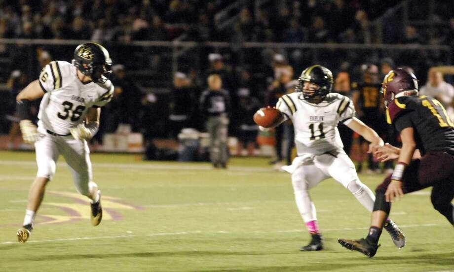 Barlow quarterback Brett Hugo, right Photo: Ryan Lacey /Hearst Connecticut Media