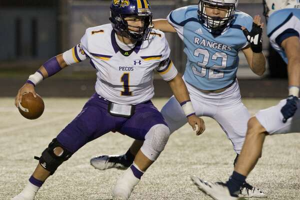 Pecos' Jonathan Aguilar tries to escape as he is chased by Greenwood's Efrain Franco and Josh Nail 10/12/18 at J.M. King Memorial Stadium. Tim Fischer/Reporter-Telegram