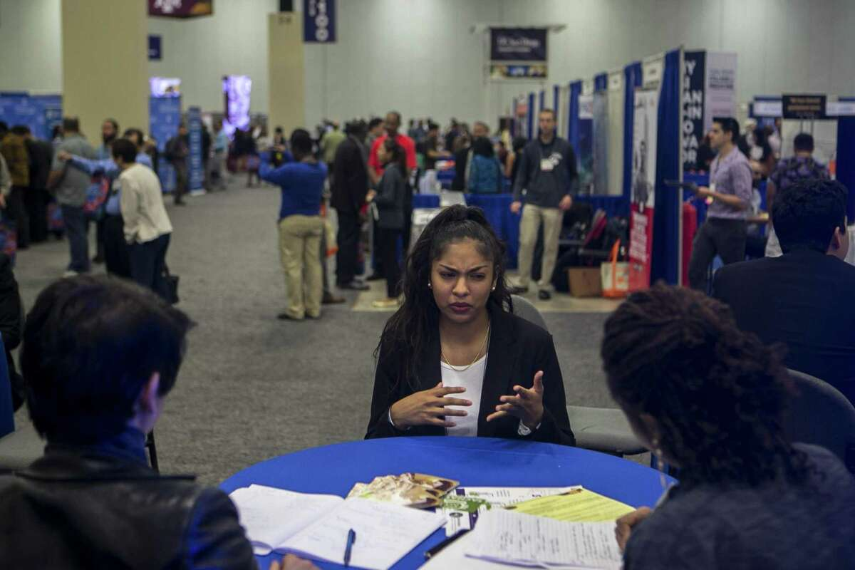 Deanna Diaz talks with professionals as she gets feedback on her CV (Curriculum Vitae) during the 45th annual National Diversity in STEM Conference, sponsored by the Society for the Advancement of Chicanos/Hispanic & Native Americans in Science at Henry B. Gonzalez Convention Center, Friday, Oct. 12, 2018. The organization's mission of inclusion, including the undocumented and LGBT population in Texas.