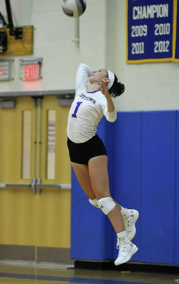 Newtown's Kim Buttery serves the ball during the Woodstock Academy at Newtown High School girls volleyball game, Sept. 17, 2018. Photo: Krista Benson / The News-Times Freelance
