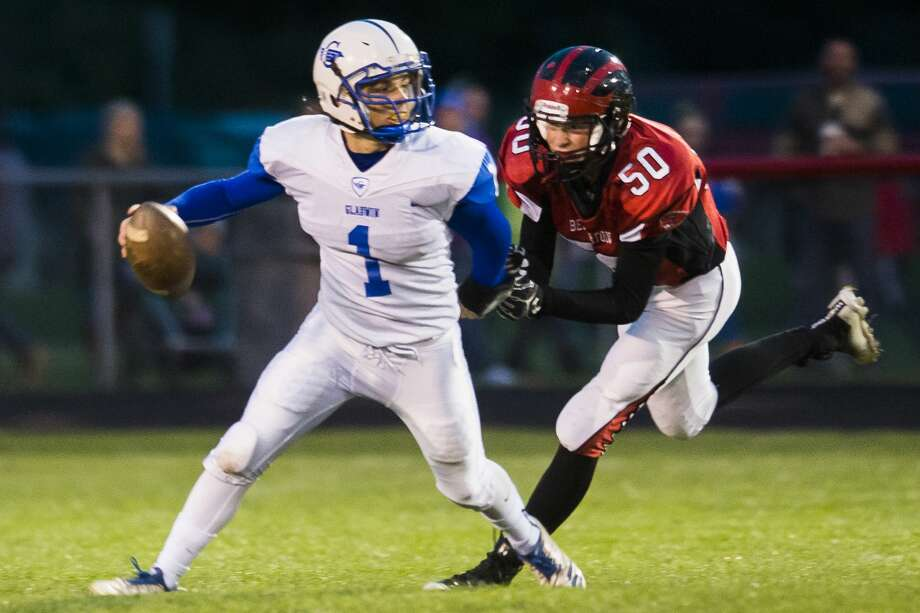 Gladwin junior Dillon Kroening looks for a teammate to pass to while Beaverton junior William Aldrich tries to tackle him during a game on Friday, Oct. 12, 2018 at Beaverton High School. (Katy Kildee/kkildee@mdn.net) Photo: (Katy Kildee/kkildee@mdn.net)