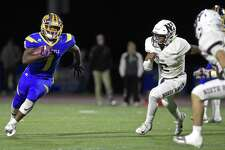 Brookfield's Nick Henderson (1) goes around the outside with North Haven's Albert Hooks (2) and Devan Brockamer (32) waiting in the football game between North Haven and Brookfield high schools, Friday night, October 12, 2018, at Brookfield High School, Brookfield, Conn.