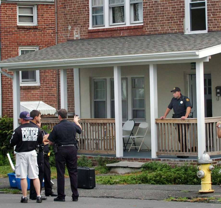 Greenwich police outside of 104 Pemberwick Road in the Pemberwick section of Greenwich, where two people were arrested for possession of marijuana, early Wednesday evening, July 14, 2010. Photo: Bob Luckey / Greenwich Time