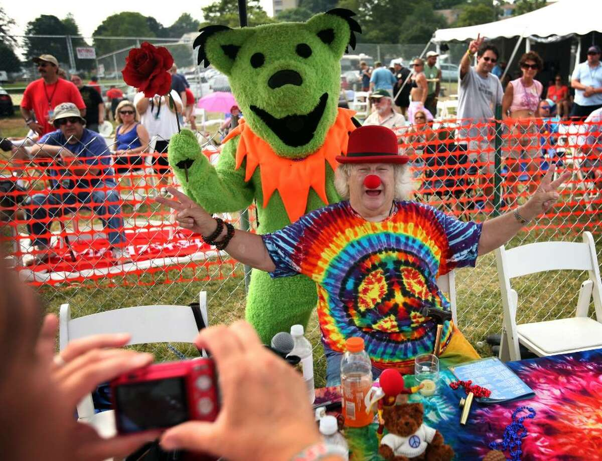 Master of ceremonies Wavy Gravy poses for a photo with a dancing bear at last year's Gathering of the Vibes. The festival returns to Seaside Park, in Bridgeport, this July 29th-August 1st.