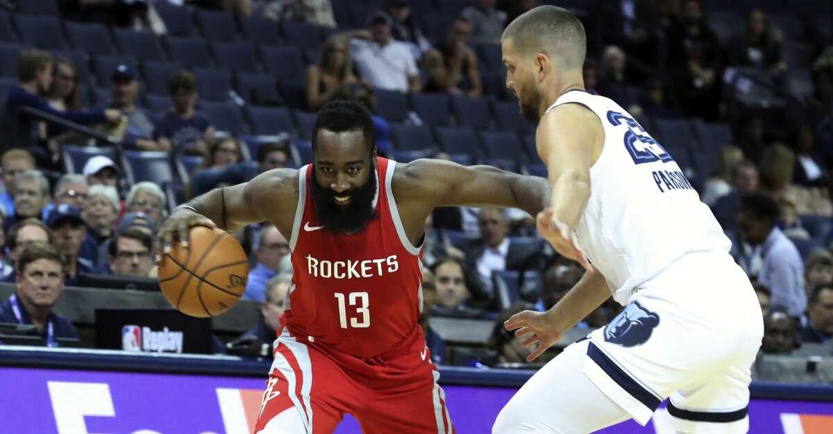 Memphis Grizzlies' Chandler Parsons (25) guards against Houston Rockets' James Harden (13) in the first half of a preseason NBA basketball game Friday, Oct. 12, 2018, in Memphis, Tenn. (AP Photo/Karen Pulfer Focht)