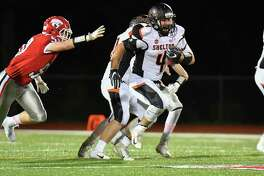 Shelton's Georgio Ghazal (4) carries the ball for a big gain against the Masuk on Friday at Masuk High School in Monroe.
