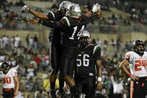 Fort Bend Hightower Hurricanes Brandon Smith (14) celebrates with Fort Bend Hightower Hurricanes Jaelon Watkins (3) after a touchdown in the fourth quarter during the high school football game between the Texas City Stingarees and the Fort Bend Hightower Hurricanes at Hall Stadium in Missouri City, TX on Friday, October 12, 2018.  The Hurricanes lead the Stingarees 24-3 in the fourth quarter.