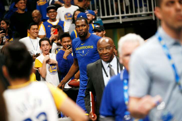 Golden State Warriors forward Kevin Durant (35) on the court for warm up before an NBA preseason game against the Los Angeles Lakers at SAP Center on Friday, Oct. 12, 2018, in San Jose, Calif.