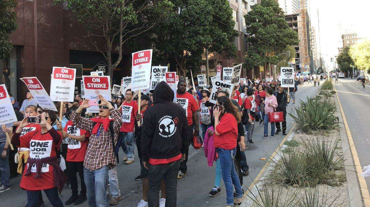 Strikers gather outside the Marriott hotel on Mission Street in San Francisco on Oct. 12, 2018.