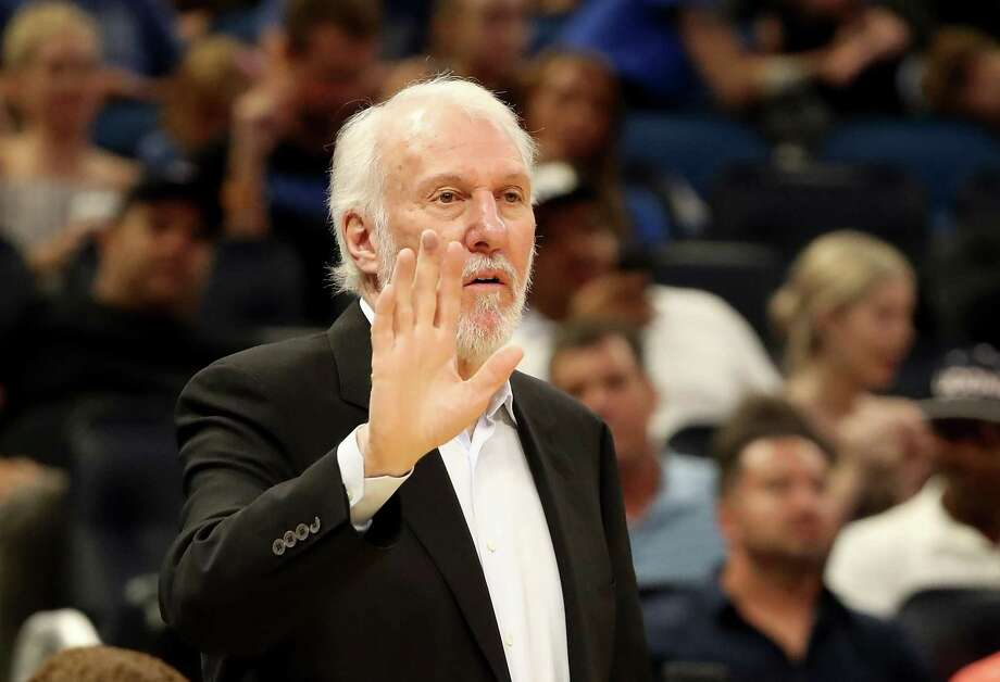 Spurs coach Gregg Popovich has fond memories of meeting George H.W. Bush when the 41st president honored the Spurs Youth Basketball League in 1992 with a Daily Point of Light Award. Photo: Sam Greenwood /Getty Images / 2018 Getty Images