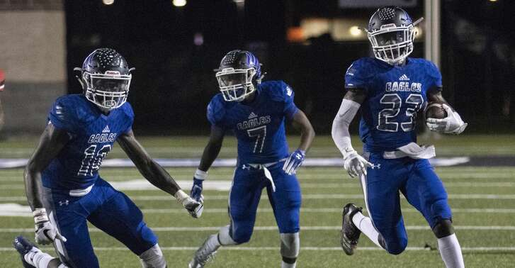 New Caney defensive back/wide receiver Jaylen Neal (23) makes a quick turn around after intercepting a Port Arthur Memorial Titans' pass during a District 9-5A (Div. I) football game Friday, Oct. 12, 2018 at Texan Drive Stadium in New Caney.