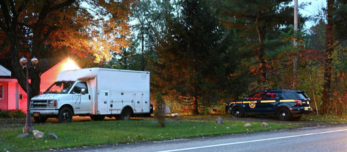 A New York State Police cruiser sits outside a bungalow at the Crest Inn, the scene of the find of a unattended death last evening Friday Oct.12, 2018 in Wilton, N.Y. (Skip Dickstein/Times Union)