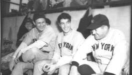 New York Yankees players Lefty Gomez (from left) and Joe DiMaggio have a laugh on the bench with manager Joe McCarthy during their game against the San Antonio Missions at Tech field in San Antonio in April 1940.