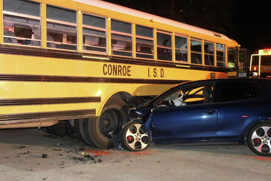 Scenes from a school bus crash on Gosling Road, one block south of Research Forest Drive. Photo: Photos By Jeff Forward/The Houston Chronicle