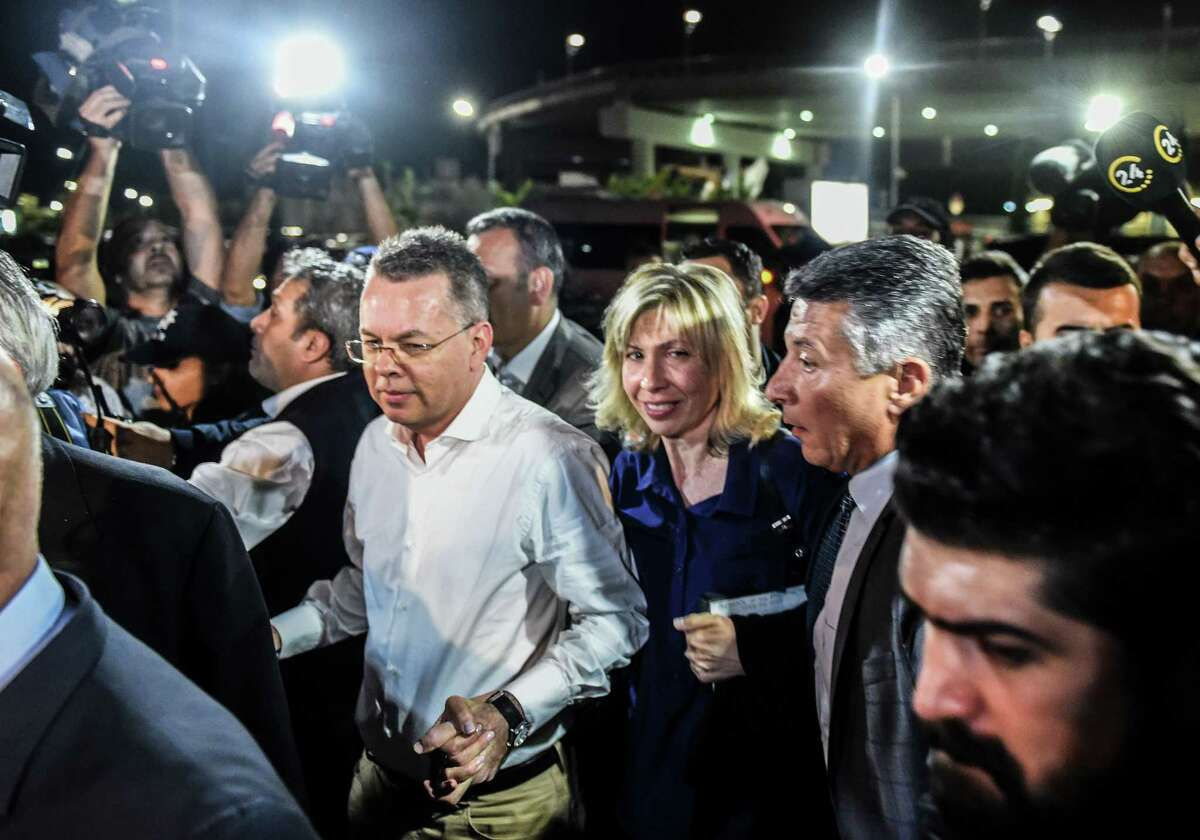 US pastor Andrew Craig Brunson (C,L) arrives at Adnan Menderes airport in Izmir, on October 12, 2018 after being freed following a trial in a court in Aliaga in western Izmir province. - US pastor Andrew Brunson, freed after a two-year detention in Turkey that shook relations between the countries, said on October 12 he was heading home soon. (Photo by BULENT KILIC / AFP)BULENT KILIC/AFP/Getty Images