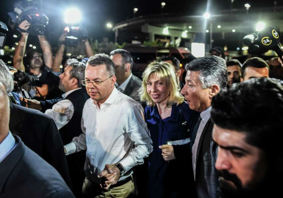 US pastor Andrew Craig Brunson (C,L) arrives at Adnan Menderes airport in Izmir, on October 12, 2018 after being freed following a trial in a court in Aliaga in western Izmir province. - US pastor Andrew Brunson, freed after a two-year detention in Turkey that shook relations between the countries, said on October 12 he was heading home soon. (Photo by BULENT KILIC / AFP)BULENT KILIC/AFP/Getty Images Photo: BULENT KILIC / AFP or licensors