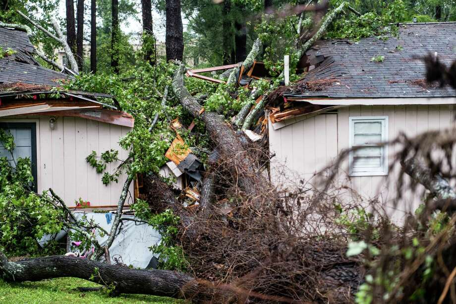 COLUMBIA, SC - OCTOBER 11: A fallen tree rests on a house after remnants of Hurricane Michael passed through on October 11, 2018 in Columbia, South Carolina. The accident sent at least one person to the hospital. (Photo by Sean Rayford/Getty Images) Photo: Sean Rayford / 2018 Getty Images