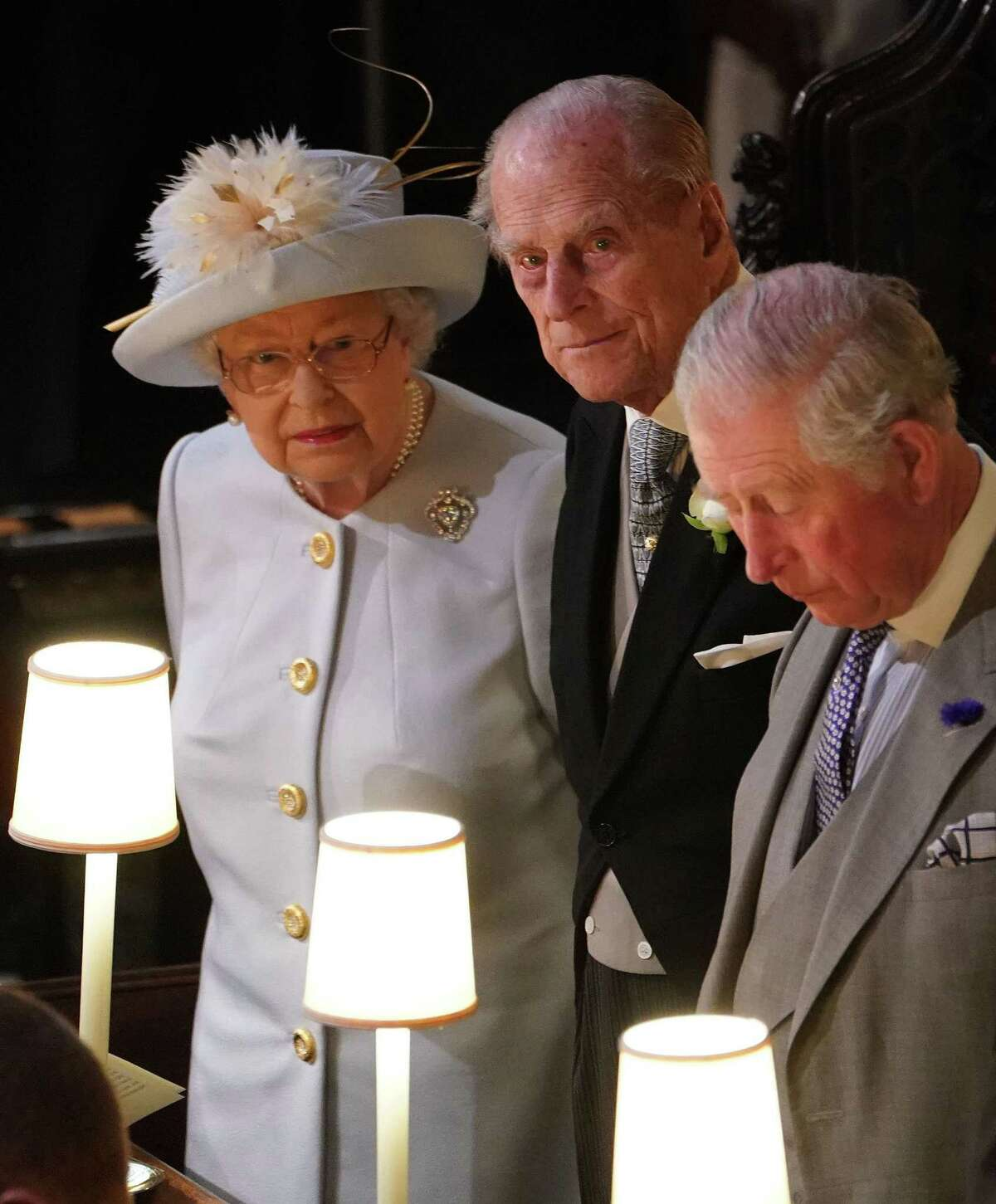 Britain's Queen Elizabeth II (L), Britain's Prince Philip, Duke of Edinburgh (C) and Britain's Prince Charles, Prince of Wales attend the wedding ceremony of Britain's Princess Eugenie of York (C) and Jack Brooksbank at St George's Chapel, Windsor Castle, in Windsor, on October 12, 2018. (Photo by Owen Humphreys / POOL / AFP)OWEN HUMPHREYS/AFP/Getty Images