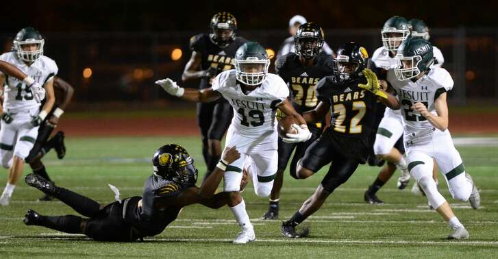 Caleb Crawford (19) of Strake Jesuit returns a kickoff in the third quarter of a high school football game between the Strake Jesuit Crusaders and the Hastings Bears on Friday, October 12, 2018 at Crump Stadium, Alief, TX.