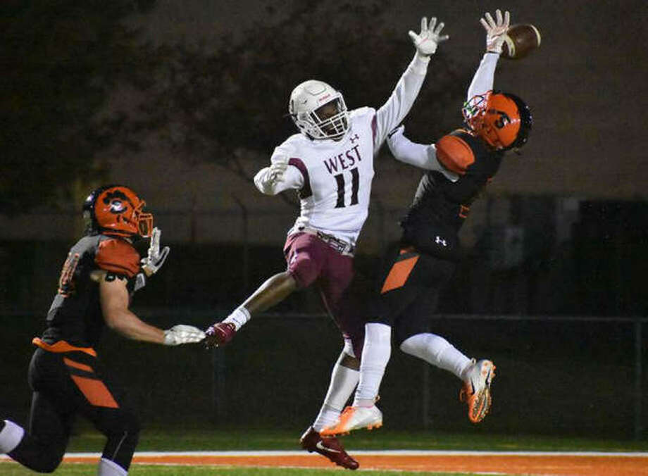 Edwardsville cornerback Jalen Cooper, right, deflects a pass away from Belleville West wide receiver Dominic Lovett during the fourth quarter on Friday at the District 7 Sports Complex. Photo: Matthew Kamp | For The Telegraph