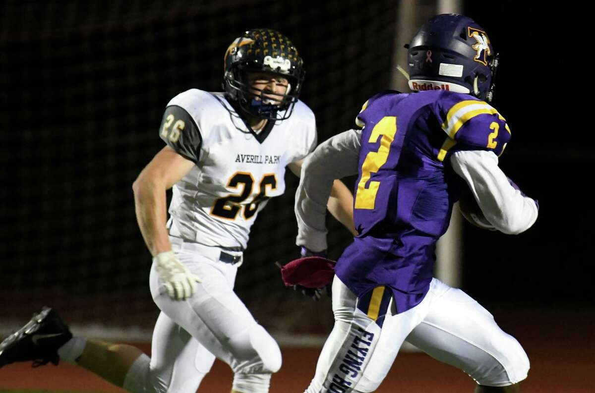 Averill Park defensive back James Finelli looks on as Troy running back Xavier Leigh runs into the end zone for a touchdown during the Capital Division title game on Friday, Oct. 12, 2018 in Troy, N.Y. (Jenn March, Special to the Times Union)