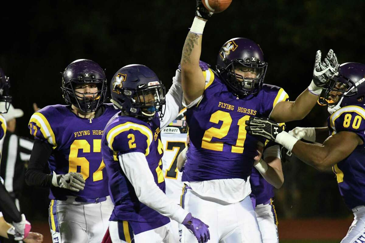 Troy football players congratulate their teammate, Kiernan Gilbert (21) for recovering a fumble by their opponent, Averill Park during the Capital Division title game on Friday, Oct. 12, 2018 in Troy, N.Y. (Jenn March, Special to the Times Union)