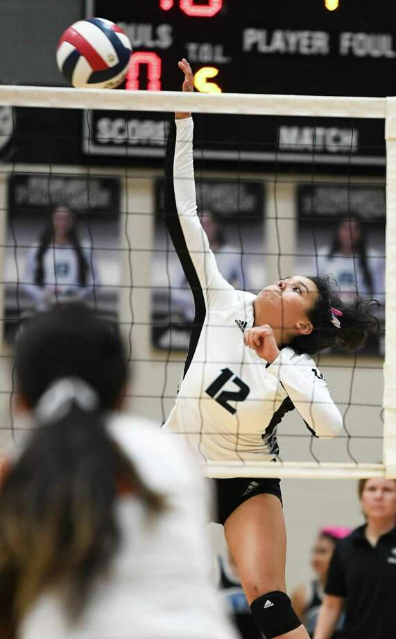 United South High School Daniella Salazar goes for a kill shot during a game against Eagle Pass High School on Friday, Oct. 12, 2018 at United South High School. Photo: Danny Zaragoza /Laredo Morning Times