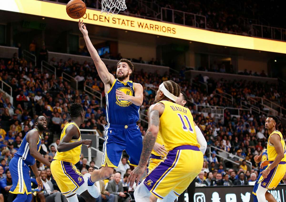 Golden State Warriors guard Klay Thompson (11) makes the lay up against the Los Angeles Lakers during the second quarter of an NBA preseason game at SAP Center on Friday, Oct. 12, 2018, in San Jose, Calif.