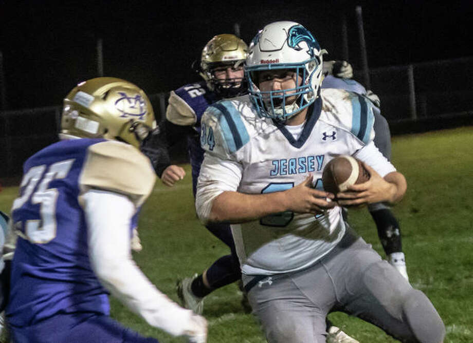 Jersey fullback Brian McDonald rumbles forward Friday night in the Panthers' 21-14 win over Civic Memorial in Bethalto. Photo: Nathan Woodside | The Telegraph