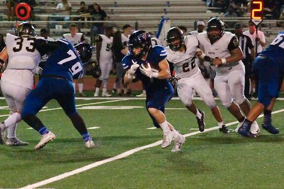 Friendswood's Luke Revere (7) picks his way through the Foster defense Friday at Friendswood High School.
