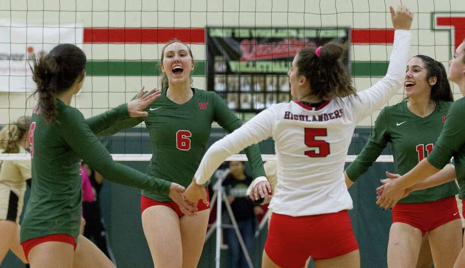 The Woodlands cheers after scoring a point during the first set of a District 15-6A high school volleyball match at The Woodlands High School, Friday, Oct. 12, 2018, in The Woodlands. Photo: Jason Fochtman, Houston Chronicle / Staff Photographer / © 2018 Houston Chronicle