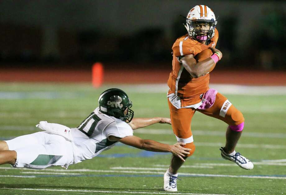 Madison and quarterback Dante Heaggans ran over Reagan on Friday. The senior accounted for six TDs against the Rattlers to take the 27-6A top spot. Photo: Marvin Pfeiffer / Staff Photographer / Express-News 2018