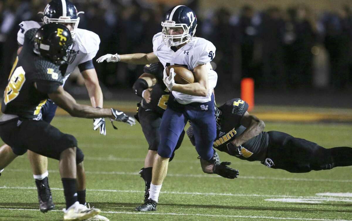 The Ranger's Kasen Wells gets by tacklers for yards as East Central hosts Smithson Valley on October 12, 2018.