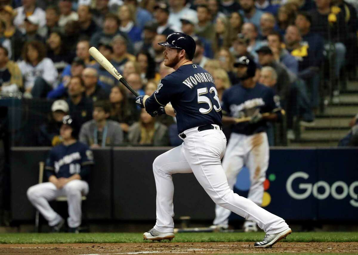 Milwaukee Brewers' Brandon Woodruff (53) hits a home run during the third inning of Game 1 of the National League Championship Series baseball game against the Los Angeles Dodgers Friday, Oct. 12, 2018, in Milwaukee. (AP Photo/Jeff Roberson)