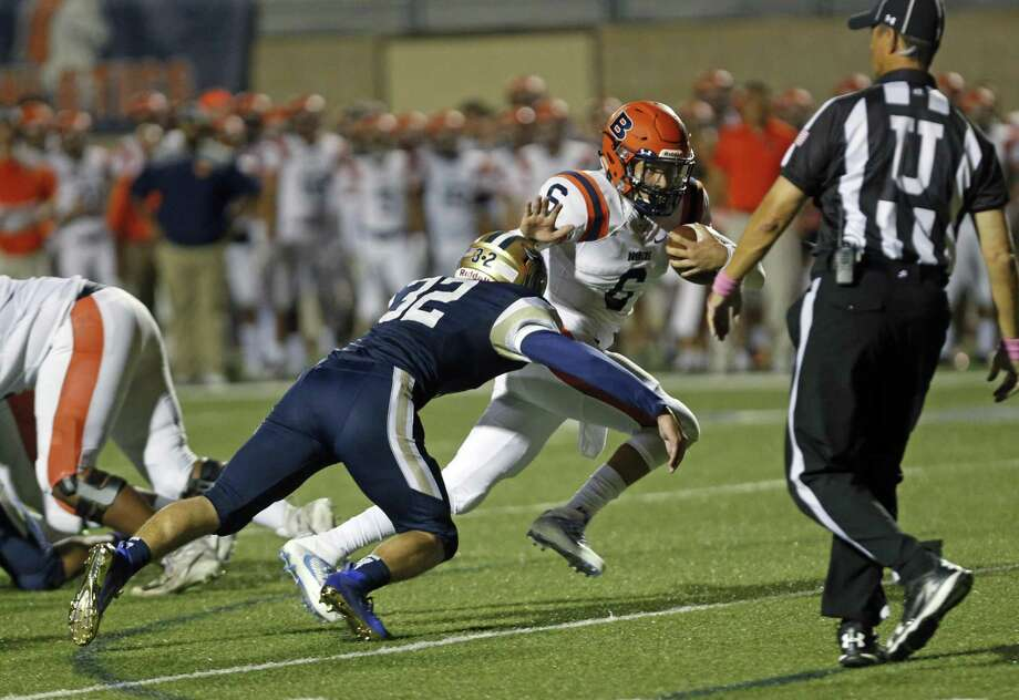 Brandeis QB Jordan Battles escapes Jonathan Renter tackle. Brandeis vs. O'Connor on Friday, October 12, 2018 at Farris Athletic Complex. Photo: Ronald Cortes/Contributor / 2018 Ronald Cortes